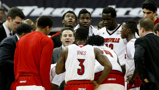 U of L head coach Rick Pitino gives instructions to his team against Pittsburgh during their game at the KFC Yum! Center.Feb. 11, 2015