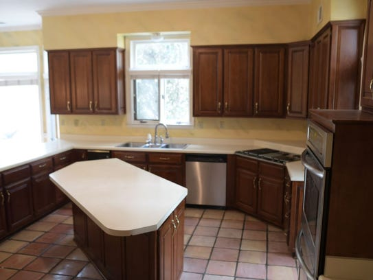 The spacious kitchen has a nice tile floor but could