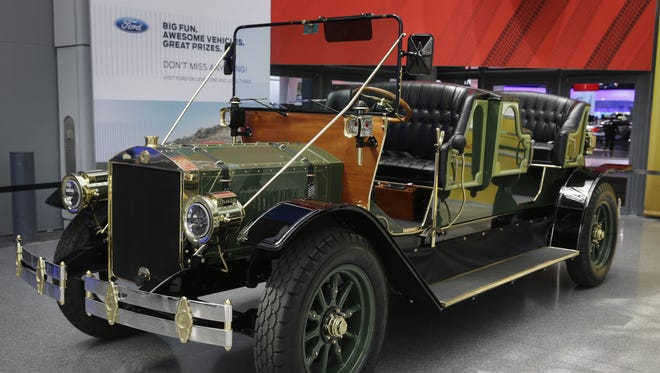 A prototype of an electric carriage is displayed at the New York International Auto Show in New York, Thursday, April 17, 2014.  Mayor Bill de Blasio would like the vehicles to take the place of horse-drawn carriages on New York City streets.