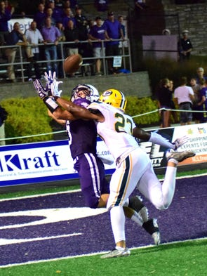 Elder's Adam Schwallie hauls in the winning touchdown