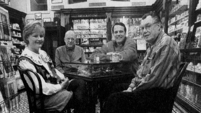 From left: Stephanie Lackey, Lewis Carpenter, Steve Crowe and Bill Carpenter, talk in the Carpenter Brothers Drug Store on Main Street. The brothers sold the business to Lackey and Crowe.