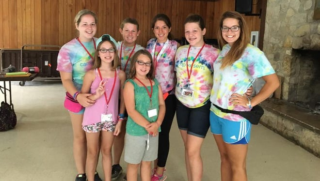 Camp Kesem attendees stand beside their counselors during the camp's first year. Last year, the group served 22 kids with families affected by cancer.