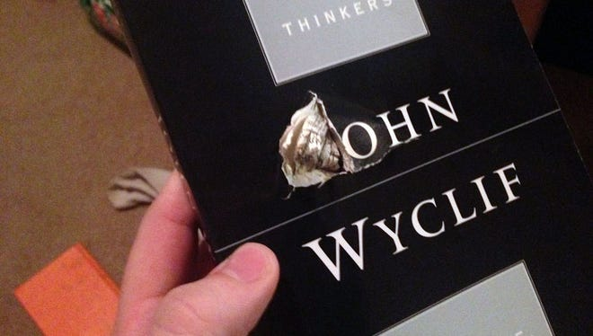 """A couple of books from Florida State University's library, including """"Great Midieval Thinkers: John Wyclif,"""" apparently saved student Jason Derfuss from becoming a shooting victim Nov. 20, 2014."""