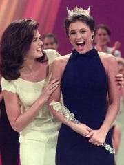 Kate Shindle, left, congratulates Miss America 1999 Nicole Johnson at the conclusion of the September 1998 pageant.