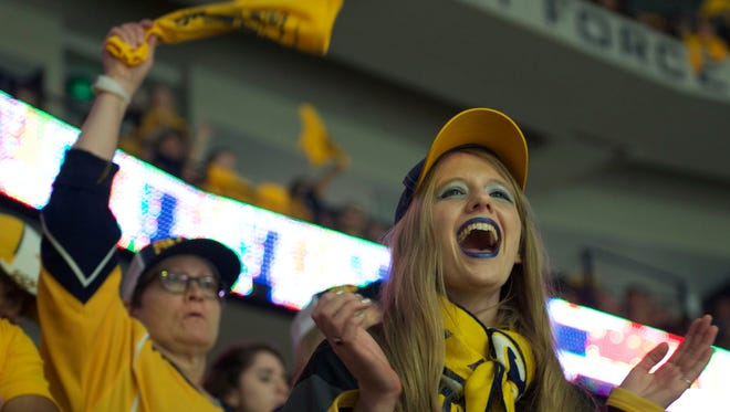 Nashville Predators fan Emily Koster, Brentwood, cheers during the second period in Game 3 of the Stanley Cup Final in Nashville, Tenn on Saturday, June 3.