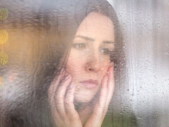 Some symptoms of seasonal affective disorder include low energy, overeating, craving carbohydrates and social withdrawal.