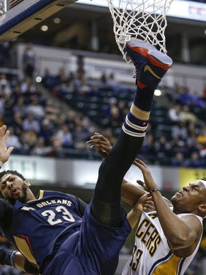 New Orleans Pelicans forward Anthony Davis (23) falls hard to the floor after body contact on a shot block attempt by Indiana Pacers center Myles Turner (33) in the second half at Bankers Life Fieldhouse on Monday, Jan. 16, 2017.