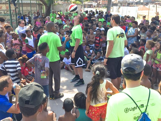 Randy Shepherd of Crossfire entertains children in Brazil by spinning a basketball.