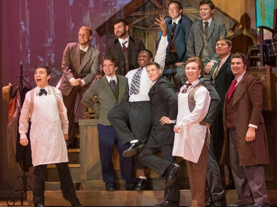 """Tyler Hamilton, center, portraying Horace Vandergelder and cast performs during a dress rehearsal of """"Hello Dolly"""" at Pensacola State College's Ashmore Auditorium on Wednesday, October 19, 2016."""