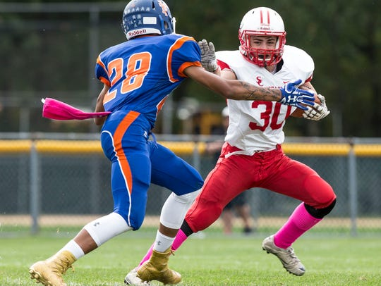 Keansburg's Gaetano Casatelli tries to tackle Point