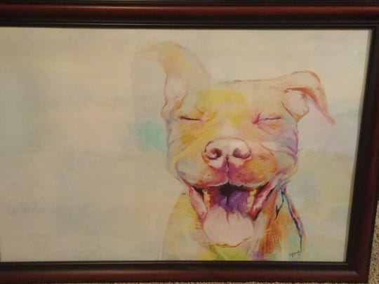 """""""The Ban is Lifted"""" by Christine Head is just one of the art pieces up for grabs at the Electric City Pittie Committee Art Auction on Friday."""