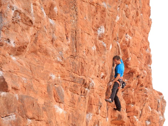 Todd Perkins climbs along the Chuckwalla Wall in St.