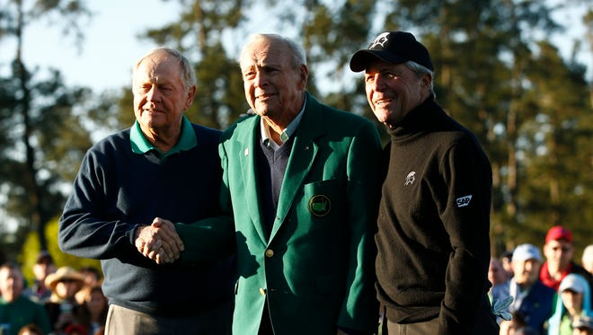 Honorary starters from left Jack Nicklaus , Arnold Palmer and Gary Player pose for a photo on the first tee during the first round of the Masters on April 7.