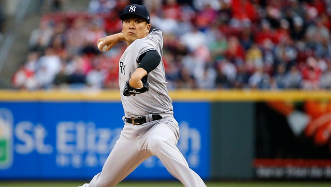 New York Yankees starting pitcher Masahiro Tanaka (19) delivers in the second inning during the interleague baseball game between the New York Yankees and the Cincinnati Reds, Monday, May 8, 2017, at Great American Ball Park in Cincinnati.