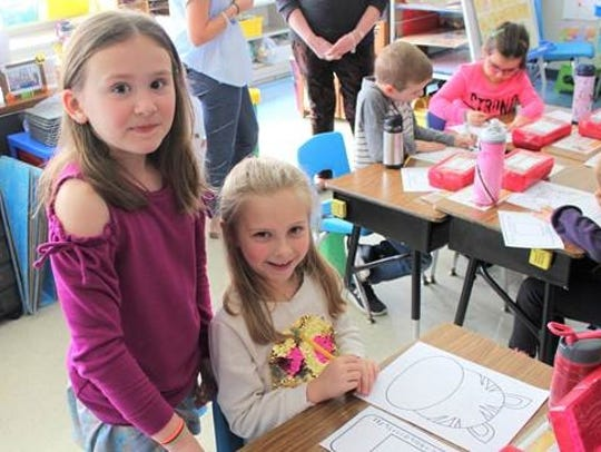 Grade 1 students Hailey Seubert and Emily Slepokura