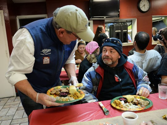 Chance Conway talks with Mayor Wade Troxell at the Fort Collins Rescue Mission's annual Great Thanksgiving Banquet on Nov. 21, 2016.
