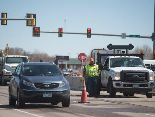 Traffic travels westbound through construction zones