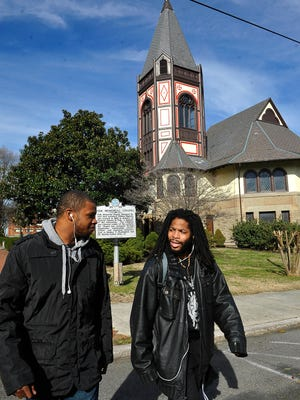 Fisk University students Semaje Stinson and Christopher Mohammed talk about a political science class they just got out of as they walk past the Fisk Memorial Chapel.