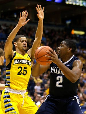 Marquette guard Haanif Cheatham will try to slow down guard Kris Jenkins and Villanova on Saturday night in Philadelphia.