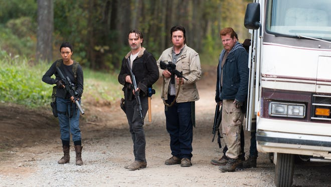 From left: Sonequa Martin-Green as Sasha, Andrew Lincoln as Rick Grimes, Josh McDermitt as Dr Eugene Porter, and Michael Cudlitz as Sgt Abraham Ford in 'The Walking Dead.'