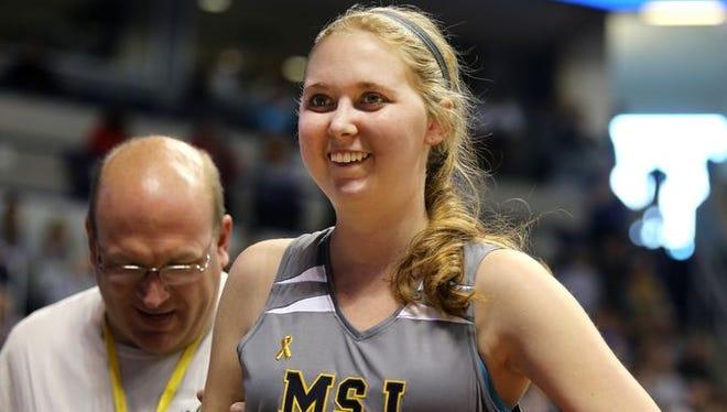 Lauren Hill took part in her first college basketball game against Hiram College at Xavier University's Cintas Center.