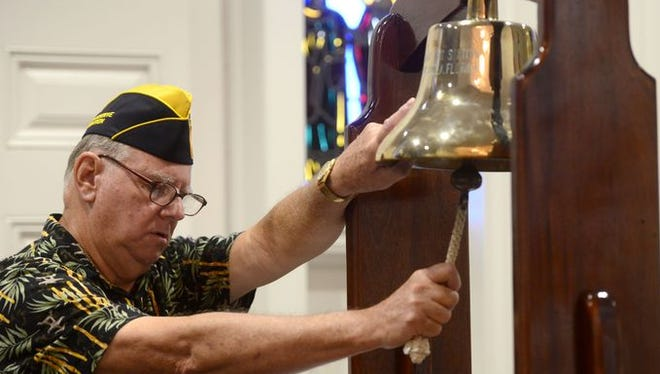 Walter Crillion, with the Fleet Reserve Association Branch 22, rings the ball during a Two Bell Ceremony on Monday as part of a a Memorial Day Service at Naval Aviation Memorial Chapel aboard Pensacola NAS.