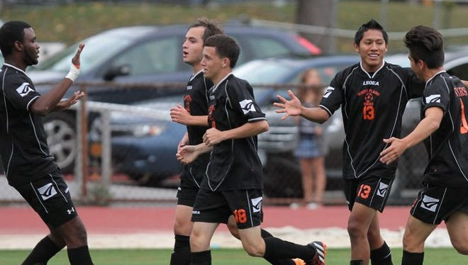 White Plains' Josue Italmanalco, second from right, celebrates with his teammates after scoring in the first half of a boys varsity soccer match against New Rochelle Oct. 2, 2014 in New Rochelle. White Plains won 1-0.