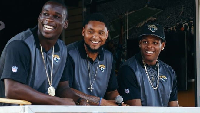 """Telvin Smith, Rashad Greene and Jalen Ramsey answer questions for fans on stage during Jacksonville's """"Tallahassee Takeover."""""""