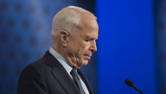 Incumbent Republican Sen. John McCain reads over notes before a debate for the U.S. Senate against his Democratic challenger, Rep. Ann Kirkpatrick, on Arizona PBS on Oct. 10, 2016, in Phoenix.