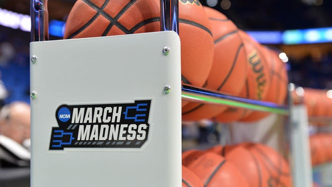 Mar 19, 2017; Tulsa, OK, USA; View of the March Madness logo on a ball rack before the game between the Kansas Jayhawks and the Michigan State Spartans in the second round of the 2017 NCAA tournament.