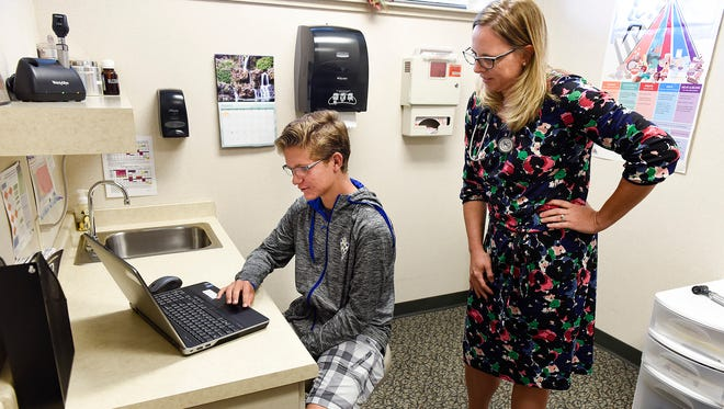 Cathedral High School soccer player Jake Manar, 14, takes a concussion base line test for Dr. Julie Anderson Friday, Sept. 1 at St. Cloud Medical Group.