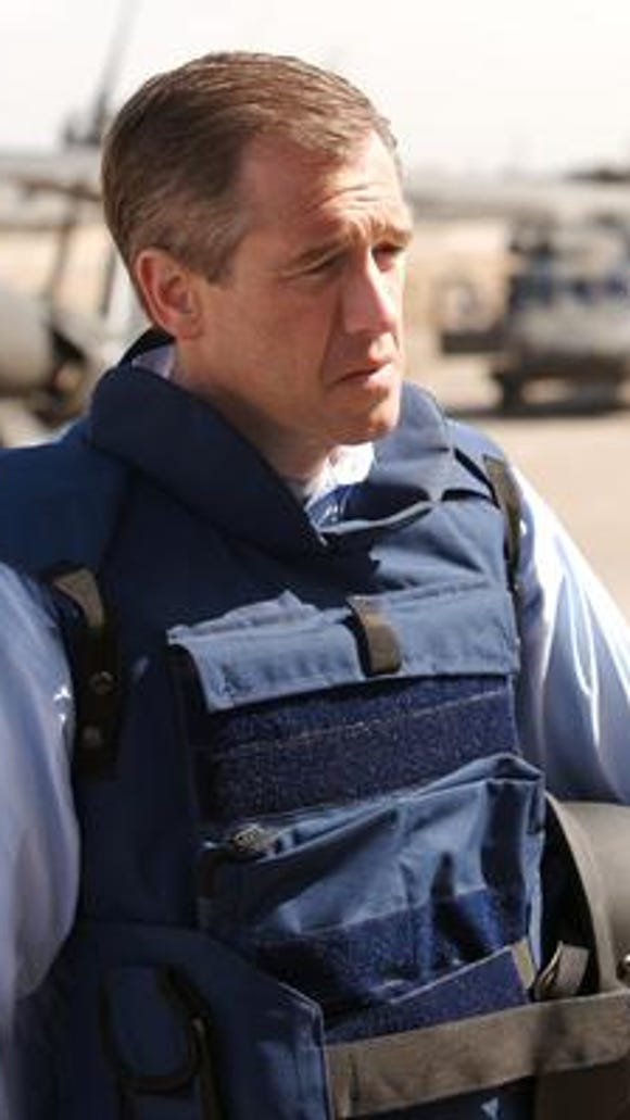 Brian Williams prepares to accept the Ring of Doom
