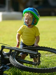 One-year-old Gabe Bokelman gets ready for the Bike