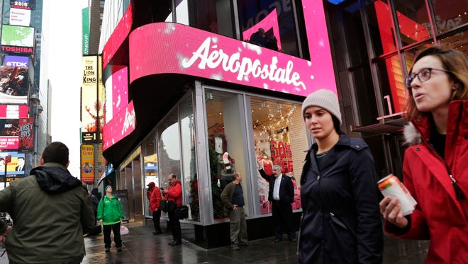 Pedestrians walk past an Aeropostale clothing store in New York's Times Square. Aeropostale plans to close 113 of its 739 U.S. stores. That includes stores at College Mall in Bloomington and Jefferson Pointe Mall in Fort Wayne but no Indianapolis-area stores.