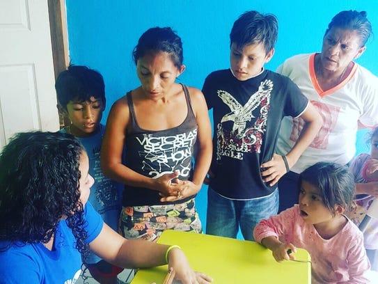 A family visits Centro de Oportunidad last week during