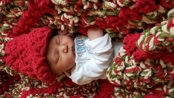 """Christmas baby"" Daniel Patrick Stauss wears his special hat and blanket."