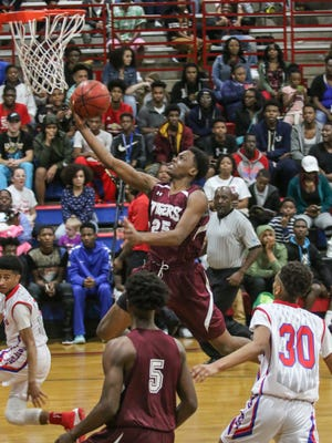 Pensacola's Javon Grimsley (25) goes for the layup against district foe Pine Forest Friday night at Pine Forest High School.