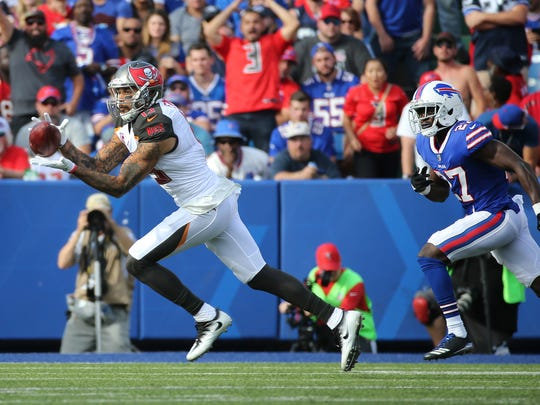 Tampa Bay receiver Mike Evans catches this pass in front of Bills Tre'Davious White.  Evans had 7 catches for 88 yards and a touchdown in the Bills 30-27 win.