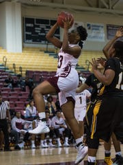 UMES center, Taryana Kelly (23) takes a shot during a game against UMBC in Princess Anne on Tuesday Dec. 16, 2015.