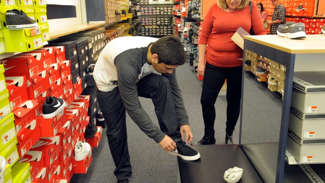Shoppers at Tulare Outlet Center's Rack Room Shoes. Councilman David Macedo noted that the city may have to reinvent the wheel a bit when it comes to revenue.