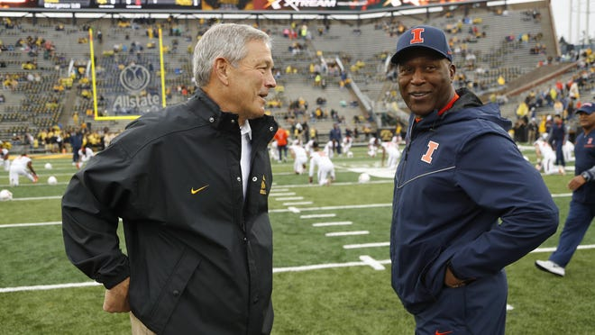 Iowa head coach Kirk Ferentz, left, talks with Illinois head coach Lovie Smith before a game, Saturday, Oct. 7, 2017, in Iowa City, Iowa.