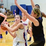 Kate Roney drives to the basket during a game earlier this season.
