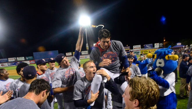 Steven Matz gets covered in champagne by his Binghamton Mets teammates after winning the Eastern League Championship at NYSEG Stadium on September 12, 2014.