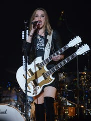 Frontwoman Lzzy Hale brings her band Halestorm, and