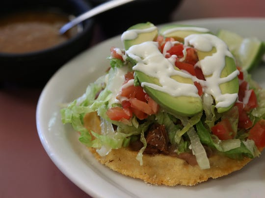 The barbacoa sope from La Pena on Indianola Avenue Sunday, Aug. 3, 2014.