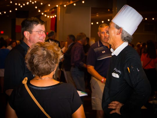 Executive Chef Gus Silivos works the crowd at the 2017
