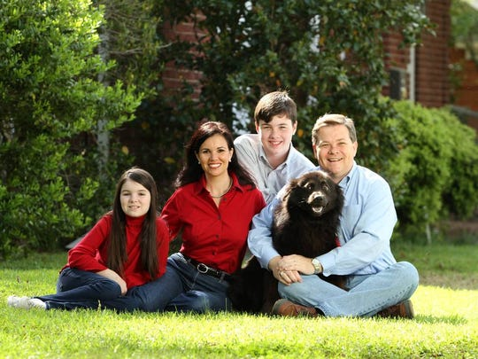 Dogs are just part of the family in the Smith household. Pictured is Democratic candidate for S.C. governor James Smith, right; his wife, Kirkland; two of four children, Thomas and Shannon; and their dogs Laffey, left, and Cayman.