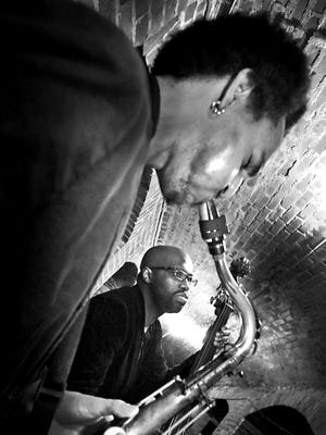 Jared Thompson on sax and Brandon Meeks on bass are part of Premium Blend.
