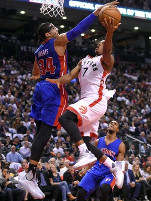 Oct 26, 2016; Toronto, Ontario, CAN; Toronto Raptors guard Kyle Lowry shoots against Detroit Pistons forward Tobias Harris in the second half at Air Canada Centre.