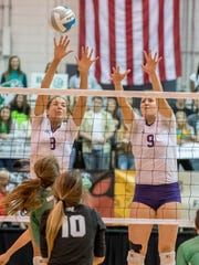 Bronson's Keona Saleman (8) and Ashton Wronikowski (9) go for the block during the 2016 Class C State Volleyball Championship at Kellogg Arena on Nov. 19, 2016.